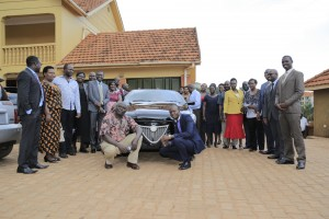 Members of rhe sessional committee on trade pose for a group photo after visiting Kiira Motors
