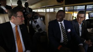 Mr. Achim Steiner ,The United Nations Environmental program's Executive Director, in the Kayoola Solar  bus together with the Kiira Kiira Motors CEO , Mr. Paul Isaac Musasizi.
