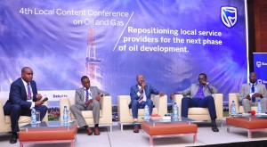 "Edwin Mucai Stanbic Bank Head of Corporate and Business Banking (1st left)  moderates a panel discussion at  the 4th Oil & Gas Local content sponsored by the Bank. Panelists were the Guest Speaker Tonye Tamuno (centre) President/CEO of Primetek Nigeria, the Public Affairs coordinator / National content Leader Total E&P Uganda Tony Otoa (2nd left), the Vice Chairman of AUGOS Dennis Kamurasi ( 2nd right) and Executive Director Uganda Petroleum Authority Ernest Rubondo (right). The conference organized under the theme ""Repositioning local service providers for the next phase of oil developments"" was held to discuss the current and future opportunities for local content providers and the standards required of them to participate in Uganda's Oil and Gas sector."