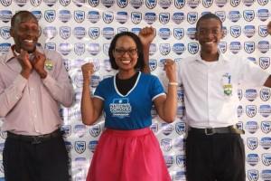 Sonia Karamagi, Head of Marketing & Communications Stanbic Bank (centre) poses for a photo with student representatives of Kibuli SS Gavin Ngabonziza (left) and Japhram Mukiibi (Right),