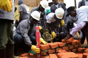 The masons are guided by Hima Cement training teams into the best way to get the job done