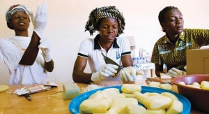 Women packaging soap made form shea butter