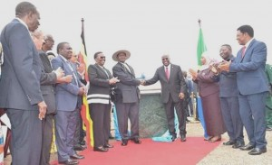 Museveni and Magufuli shake on it after unveiling the foundation stone