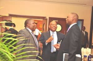 Jimmy Mugerwa, the Tullow Oil Uganda General Manager has a chat with Mbire and Mweheire at the conference