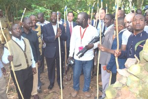 Minister of state for tourism Godfrey Kiwanda being showed the Henry Morton Stanley imcomplete building in the forest that could become an attraction for tourists if developed.
